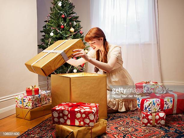 Woman unpacking large christmaspresent.