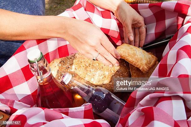 Woman unpacking picnic basket