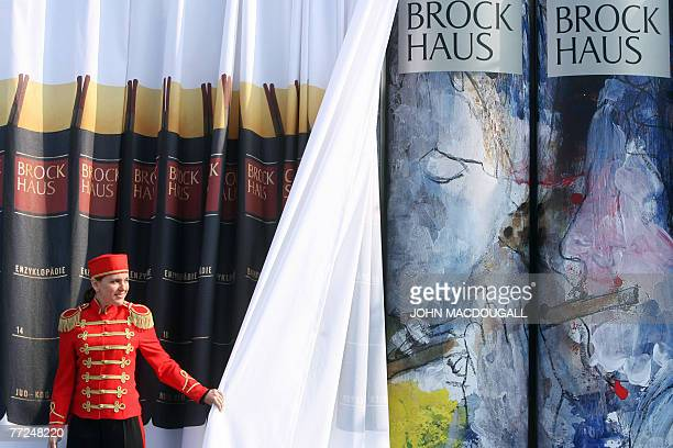 A woman unveils a new edition illustrated by German actor and painter Armin MuellerStahl of the Brockhaus encyclopedia at the Frankfurt Book Fair 10...