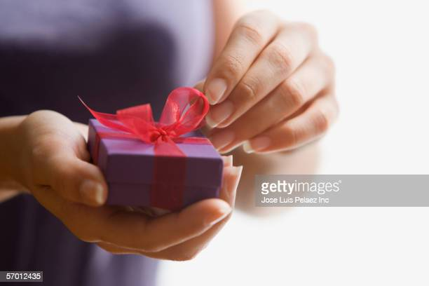 Woman unwrapping small present