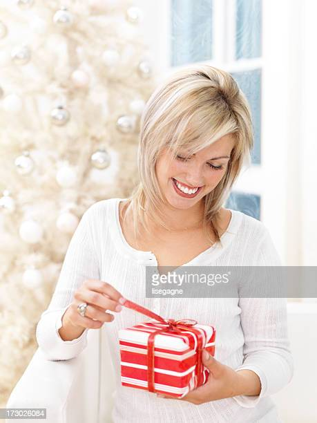 Woman Unwrapping Xmas Gift
