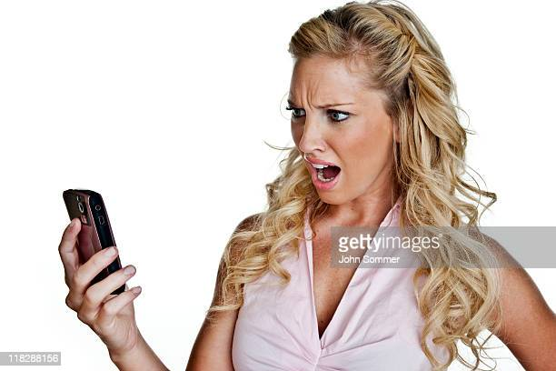 Woman upset holding a cellphone