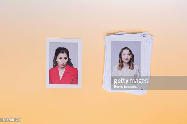 Woman upset next to woman on top of pile of photos
