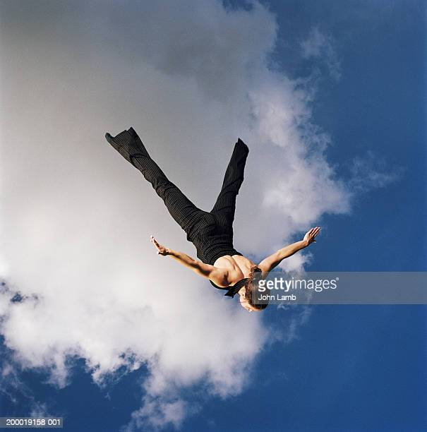 Woman upside down in mid air, arms outstretched