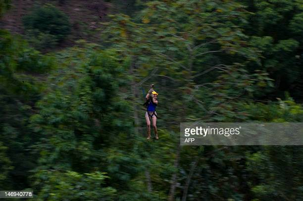 A woman uses a canopyg rope in the Patrocinio Natural Reserve in the Quetzaltenango department 196 km southwest of Guatemala City on June 22 2012 The...