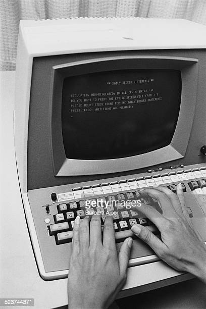 A woman uses a computer to print daily broker statements at PMA Commodities Boston Massachusetts USA 16th August 1977