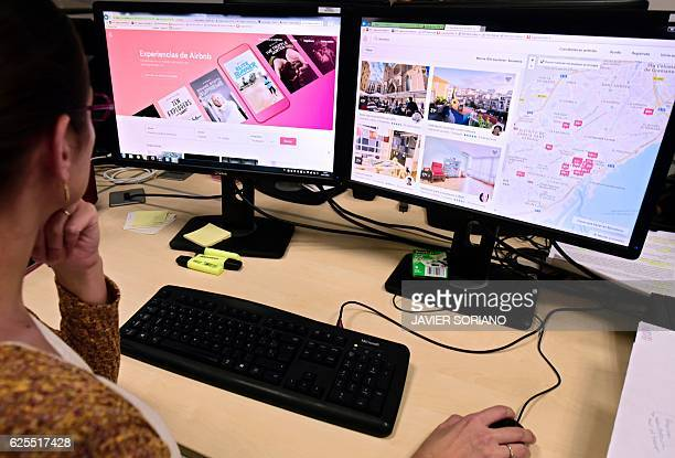 A woman uses a computer to visit home rental website Airbnb in Madrid on November 24 2016 Barcelona city hall said today it would fine home rental...