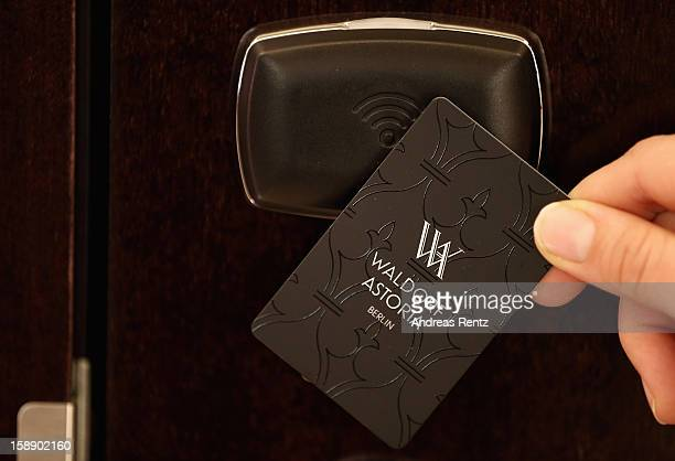 A woman uses a key card to open the door during the opening of Germany's first Waldorf Astoria hotel on January 3 2013 in Berlin Germany The luxury...
