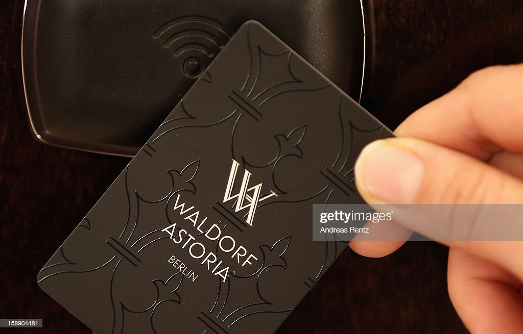 A woman uses a key card to open the door during the opening of Germany's first Waldorf Astoria hotel on January 3, 2013 in Berlin, Germany. The luxury Waldorf Astoria Berlin with its 232 luxury guest rooms and suites on 32 storeys is located near the Kaiser Wilhelm Memorial Church (Kaiser-Wilhelm-Gedächtniskirche).