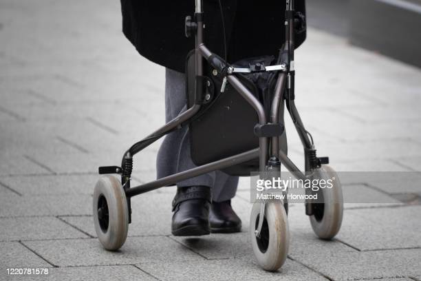Woman uses a mobility walker on the street on March 09, 2020 in Cardiff, United Kingdom.