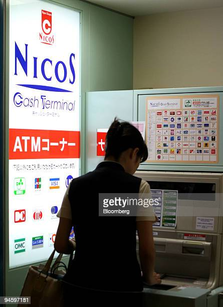 A woman uses a Nicos automated teller machine in Tokyo Japan on Friday Sept 7 2007 Mitsubishi UFJ Nicos Co the credit card arm of Japan's biggest...