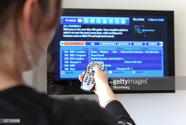 Woman uses a Sky remote control in Romford, U.K., on Tuesday, June 15, 2010. British Sky Broadcasting Plc, the U.K.'s largest pay-TV provider,...