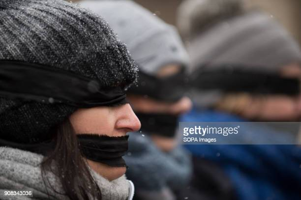 A woman uses black bands over her eyes and mouth during a silent assembly named Stolen Justice in Krakow Stolen Justice happening intend to express...