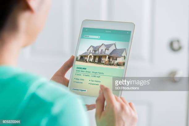 woman uses digital table to search for new home - real estate stock pictures, royalty-free photos & images