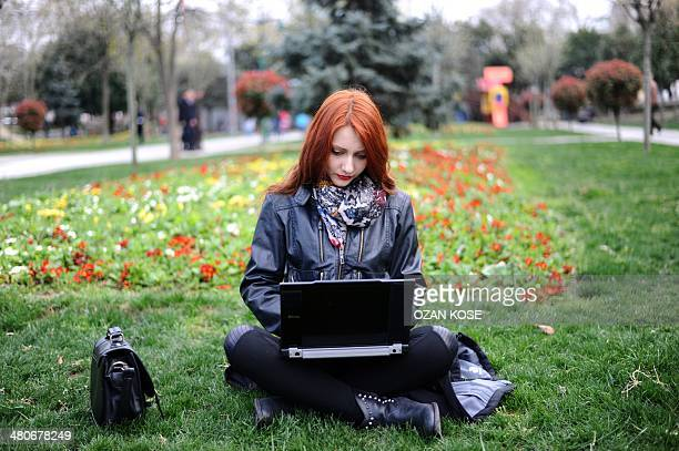 A woman uses her laptop on March 26 2014 in Istanbul A Turkish court overturned today the government's controversial Twitter ban imposed after audio...