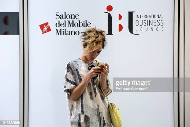 A woman uses her mobile phone during the Salone Internazionale del Mobile at Fiera di Rho on April 17 2018 in Milan Italy Every year Salone and...