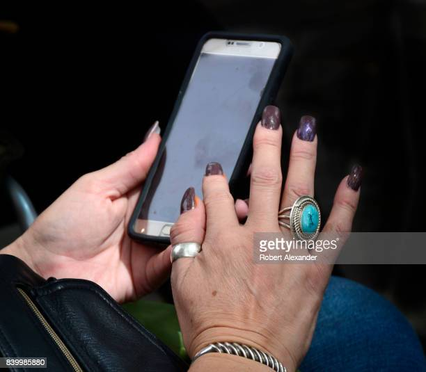 A woman uses her Samsung smartphone in Santa Fe New Mexico