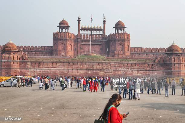 A woman uses his cellphone in the premises of the Red Fort in Old Delhi India 08 December 2019
