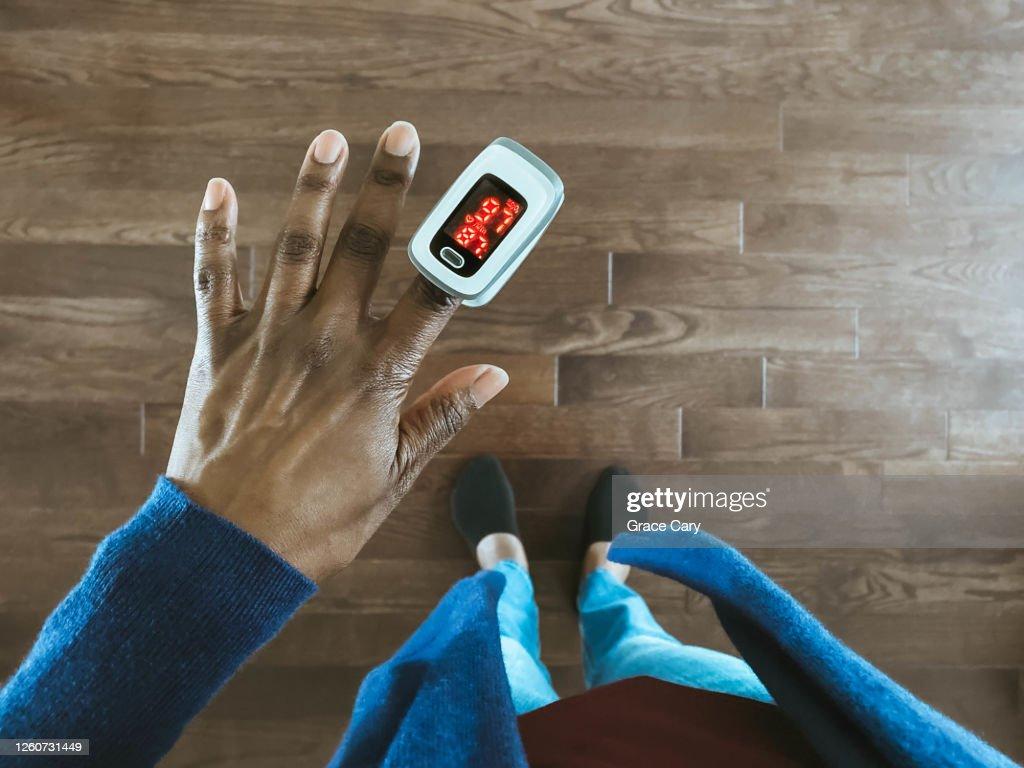 Woman Uses Pulse Oximeter : Stock Photo