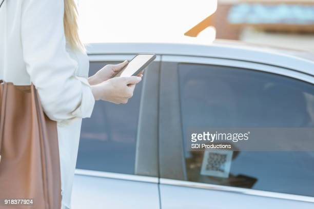 Woman uses ride share app after a day of shopping