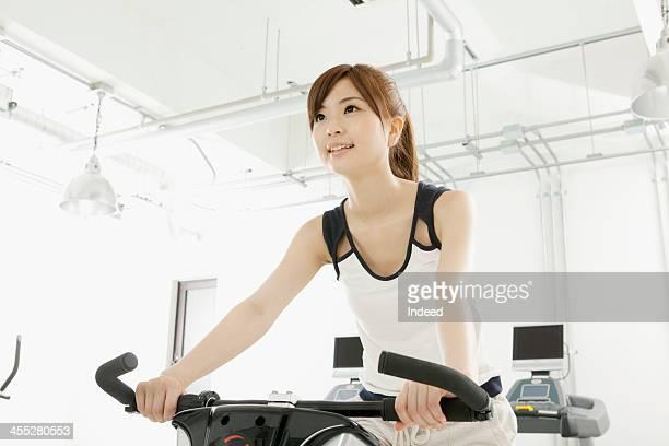 Woman uses the exercise bike