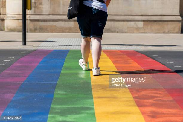 A woman uses the first permanent rainbow crossing to show support for the Wandsworth borough's LGTBQ community outside the iconic Battersea Arts...
