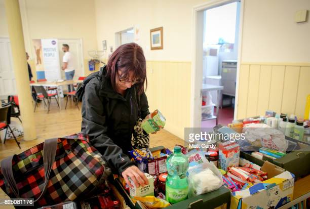 A woman uses the foodbank run by the charity Transformation CPR being run at the Camborne Centenary Methodist Church in Camborne on July 25 2017 in...