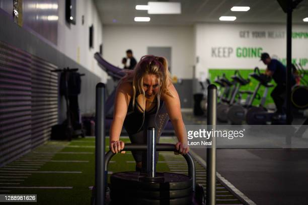 Woman uses the gym facilities at Kensington Leisure Centre on the first day of re-opening after the latest lockdown ended, on December 02, 2020 in...
