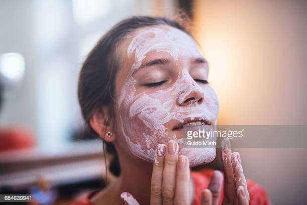 woman using a beauty mask. - body care stock pictures, royalty-free photos & images