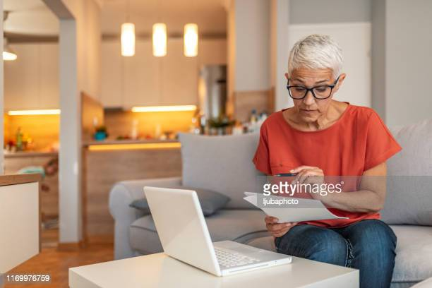 woman using a computer - examining stock pictures, royalty-free photos & images