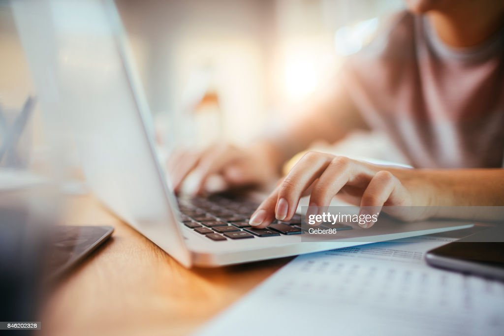 Woman using a computer : Stock Photo