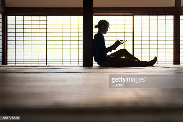 Woman using a digital tablet in a Japanese temple