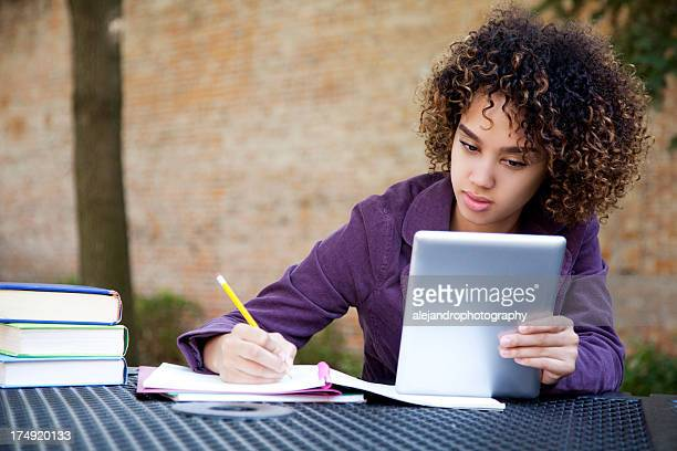 Woman using a digital tablet to study