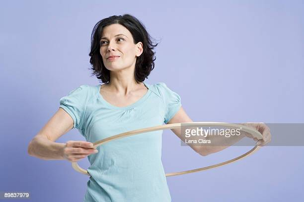 A woman using a hula hoop