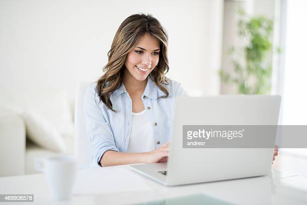 Woman using a laptop computer at home