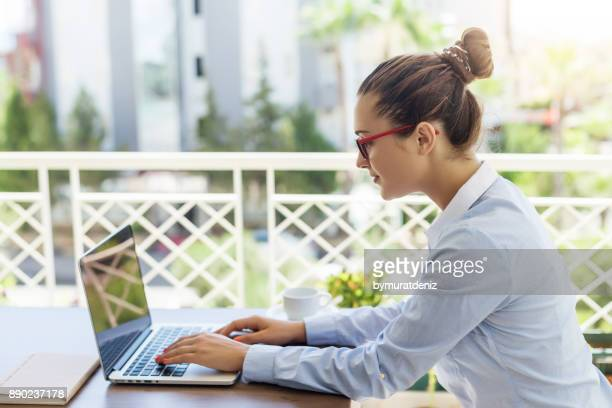 Woman using a laptop in an apartment