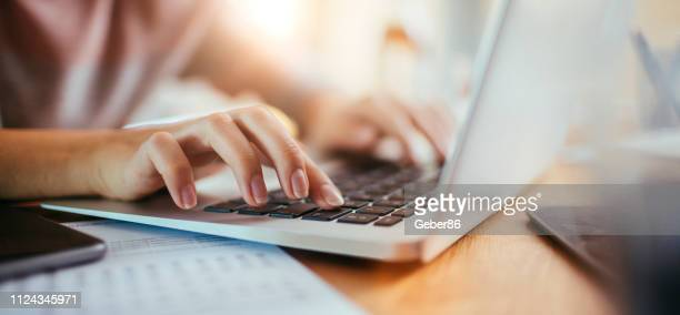 woman using a laptop - remote work stock pictures, royalty-free photos & images