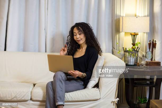 A woman using a laptop