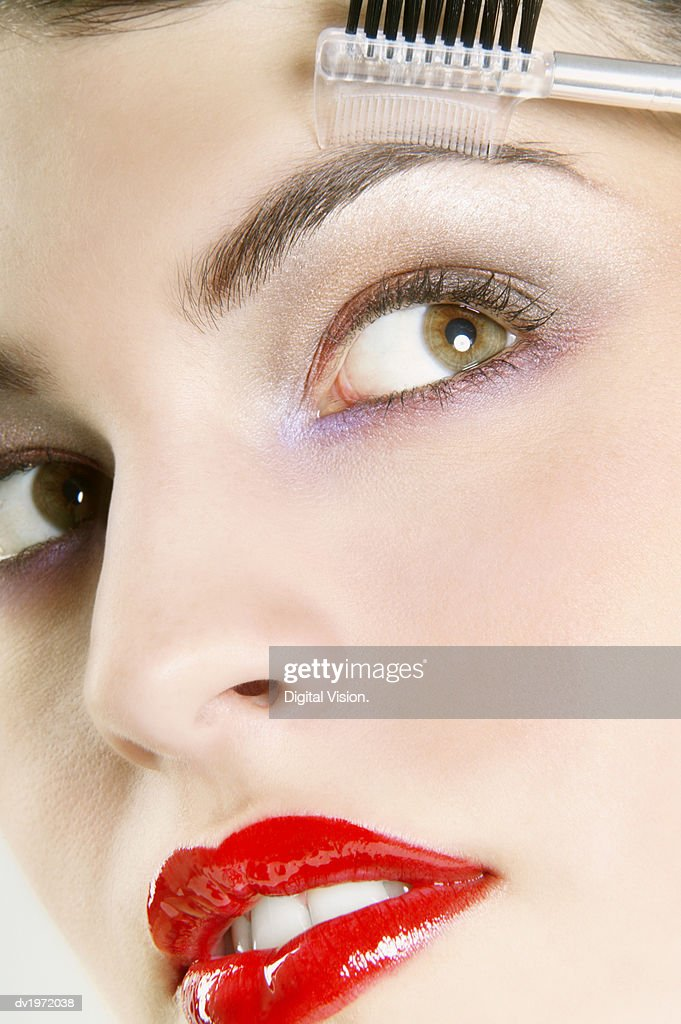 Woman Using a make Up Brush on Her Eyebrow : Stock Photo