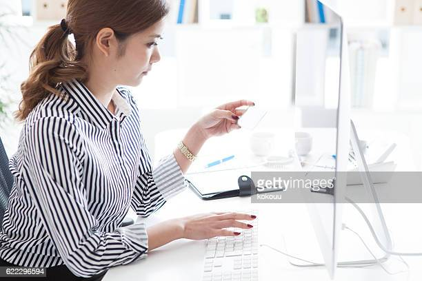Woman using a personal computer at the office