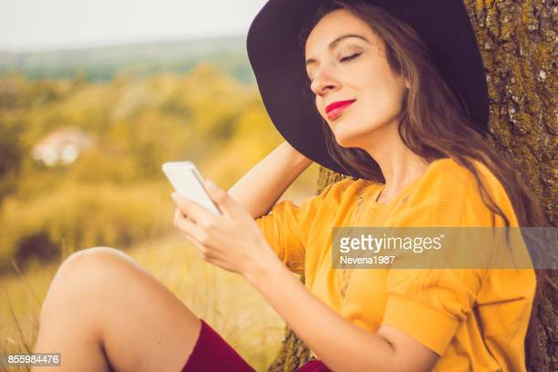 woman using a phone in the nature