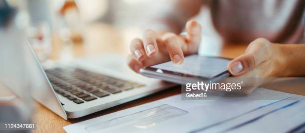 woman using a phone - person on laptop stock pictures, royalty-free photos & images