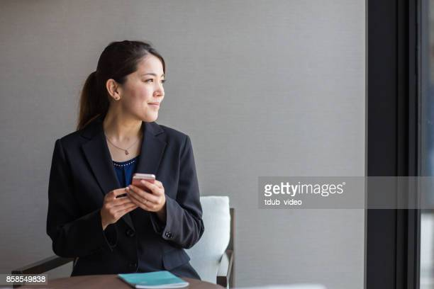 A woman using a phone