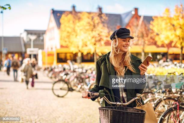 woman using a phone - city life stock pictures, royalty-free photos & images