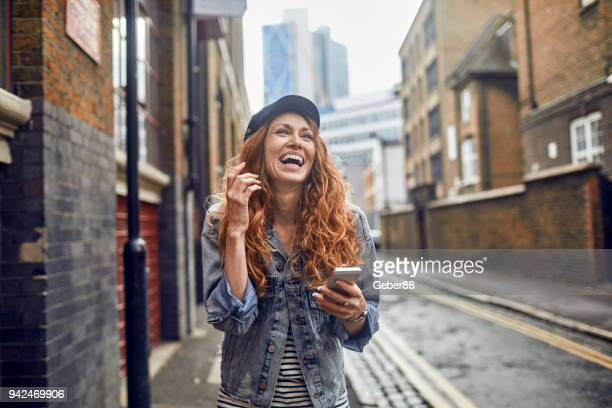 woman using a phone - surfing the net stock pictures, royalty-free photos & images