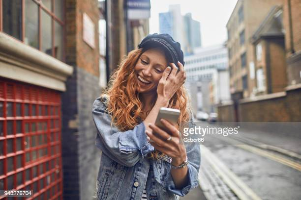 woman using a phone - one young woman only stock pictures, royalty-free photos & images