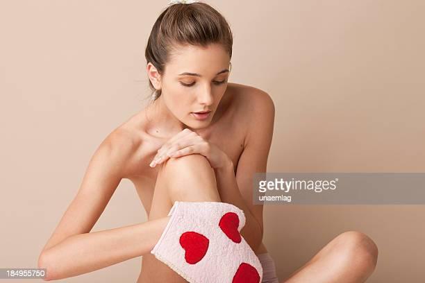 woman using a pink scrub glove