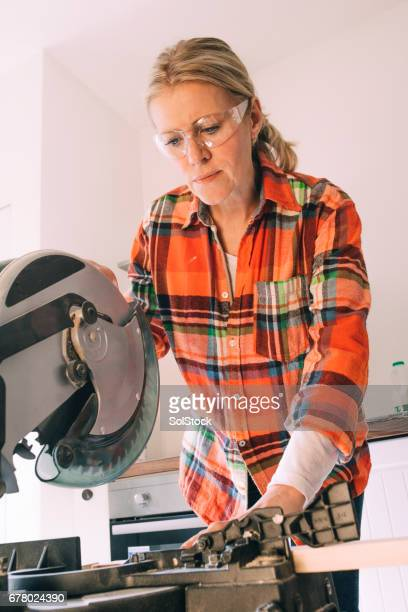 Woman Using A Power Tool