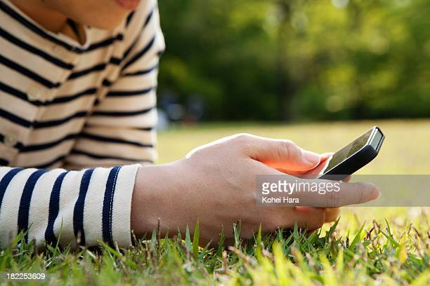 woman using a smart phone in the park