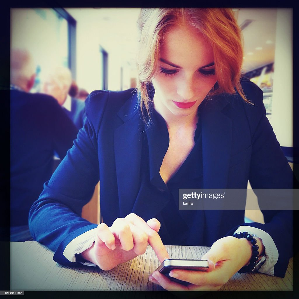 Woman using a smart phone : Stock Photo
